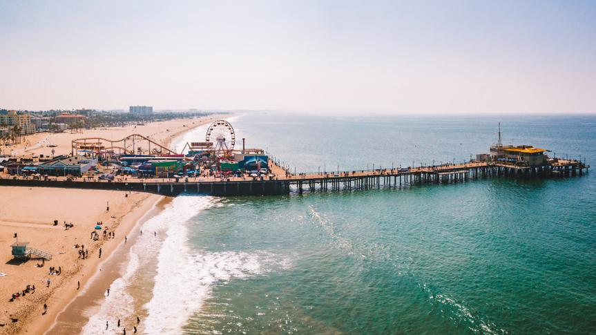 Los Angeles, California, USA - September 12, 2018: Aerial view on the Santa Monica amusement park with roller coaster and ferris wheel near Venice beach in Los Angeles, California.