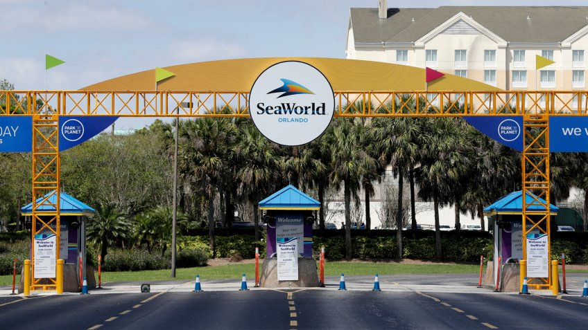 The entrance to the SeaWorld Theme park remains closed, in Orlando, Fla.