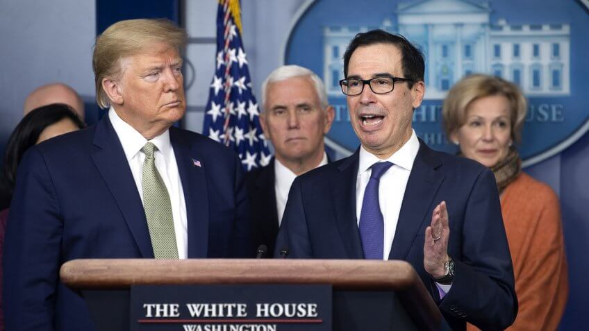 United States Secretary of the Treasury Steven Mnuchin, second right, joined by US President Donald Trump, left, US Vice President Mike Pence, center left, Dr.
