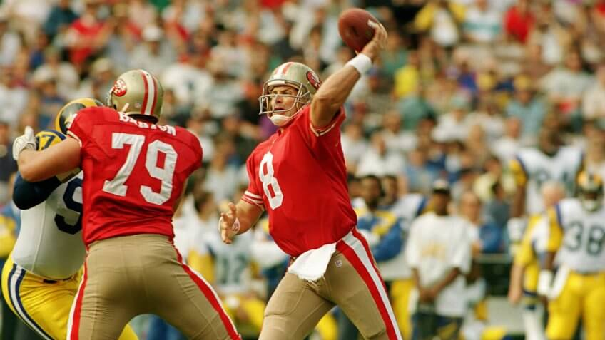 Young San Francisco 49ers' quarterback Steve Young (8) throws a pass against the Los Angeles Rams in Anaheim Stadium49ERS YOUNG, ANAHEIM, USA.