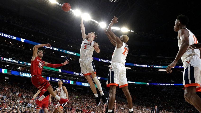 Texas Tech guard Davide Moretti left, shoots over Virginia's Kyle Guy (5) and Mamadi Diakite during the first half in the championship game of the Final Four NCAA college basketball tournament, in MinneapolisFinal Four Texas Tech Virginia Basketball - 08 Apr 2019.