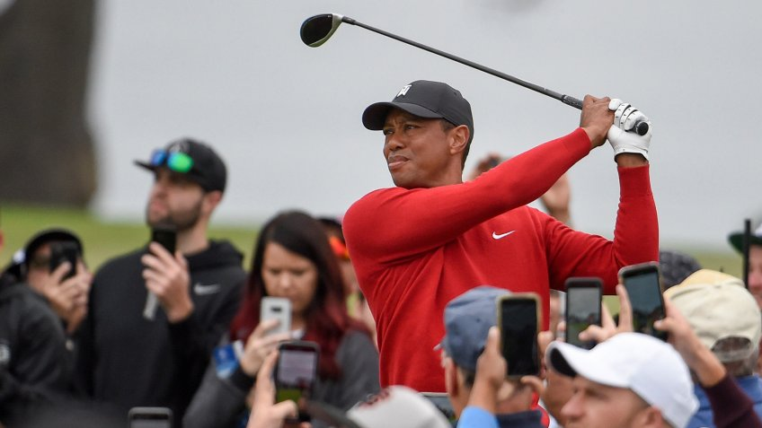 Mandatory Credit: Photo by Denis Poroy/AP/Shutterstock (10554134a)Tiger Woods watches his tee shot on the second hole of the South Course at Torrey Pines Golf Course during the final round of the Farmers Insurance golf tournament Sunday, in San Diego.