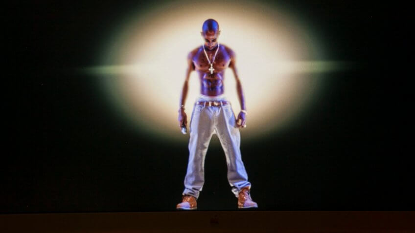 Mandatory Credit: Photo by Damian Dovarganes/AP/Shutterstock (6244237c)Tupac Shakur A video image of the Tupac Shakur hologram is displayed on a computer monitor at the Subtractive Studio in Santa Monica, Calif.
