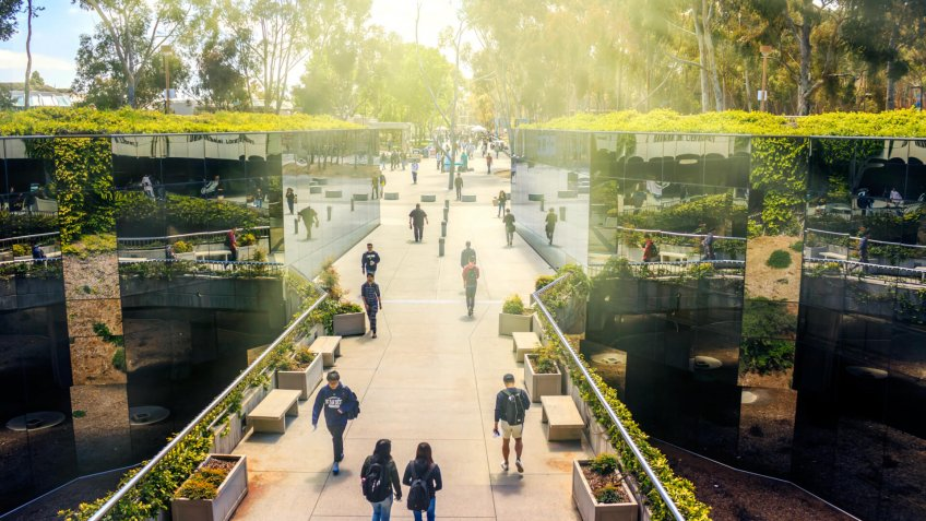 La Jolla, California, USA - April 3, 2017: The mirrored pathway to Geisel Library, the main library at the University of California, San Diego (UCSD), reflecting the students passing by.