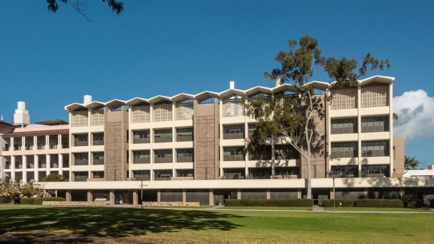 Santa Barbara, California, USA - January 6, 2019: The white and beige modern chemistry building of UCSB, behind green lawn and under blue sky.
