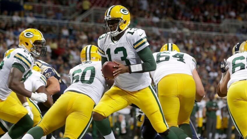Mandatory Credit: Photo by Seth Perlman/AP/Shutterstock (6020240dk)Vince Young Green Bay Packers quarterback Vince Young hands off during the third quarter of an NFL football game against the St.