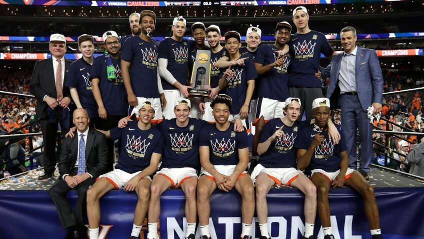 Virginia players celebrate after the championship game against Texas Tech in the Final Four NCAA college basketball tournament, in Minneapolis.