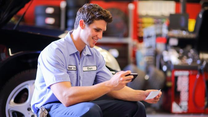 Auto Mechanic Depositing Check with Mobile Phonehttp://i449.