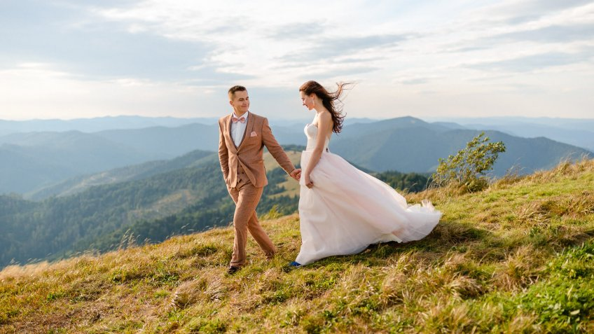 Young love couple celebrating a wedding in the mountains.