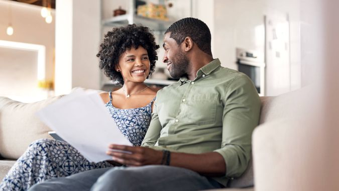 Shot of a young couple going through paperwork at home.