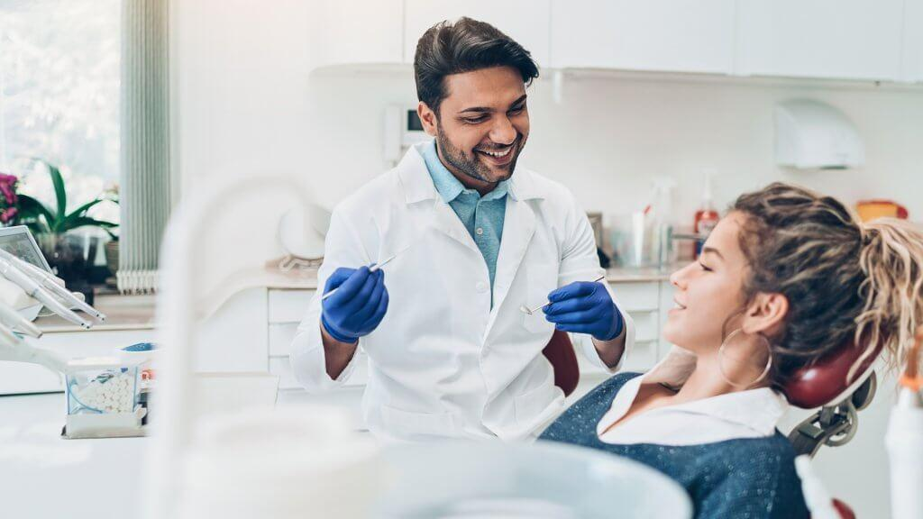 Dentist and female patient in the dentist's office.