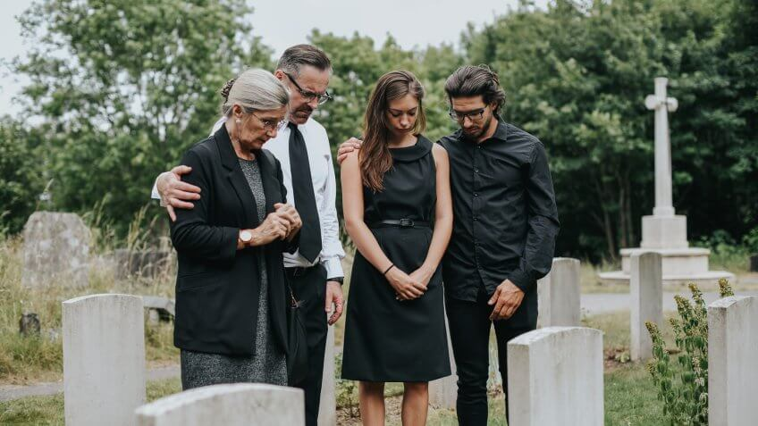 Family giving their last goodbyes at the cemetery.
