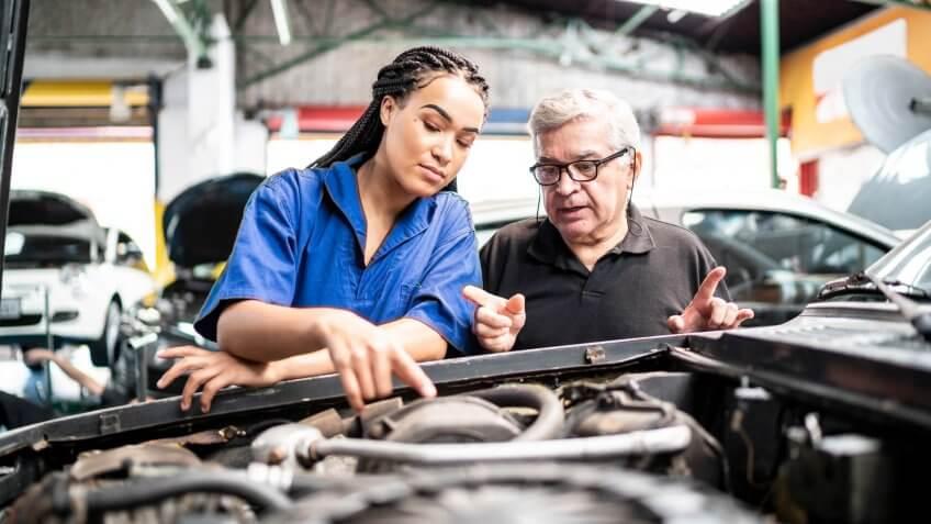 Mechanic partners in a auto repair shopu.