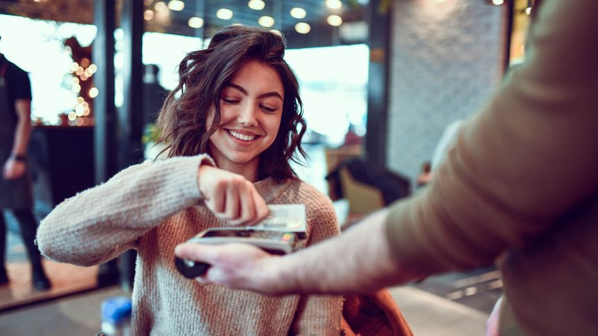Female Paying With Credit Card In Restaurant.