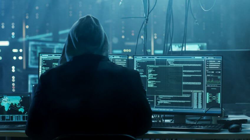 Dangerous Hooded Hacker Breaks into Government Data Servers and Infects Their System with a Virus.