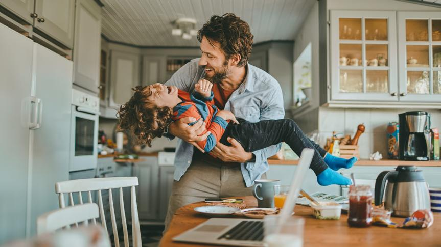 Close up of a family having breakfast and playing with each other.