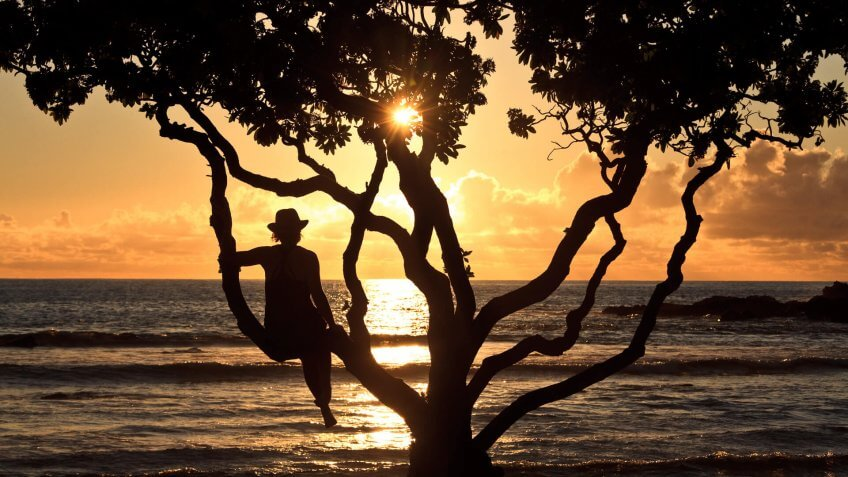 A caucasian women relaxing on a tropical beach in Hawaii.