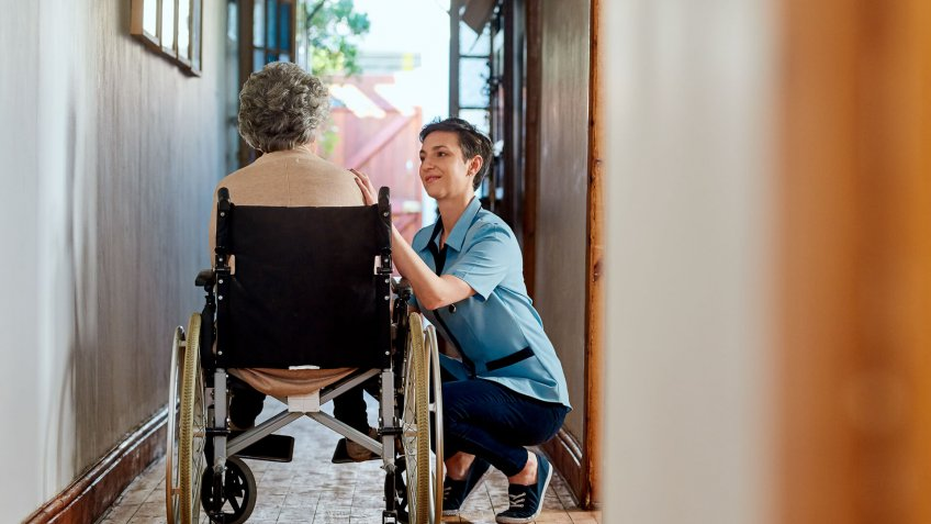 Shot of a nurse caring for a senior patient in a retirement home.