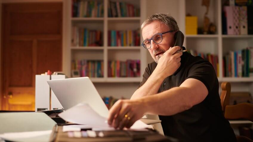 mature man working from home or sorting the home finances.