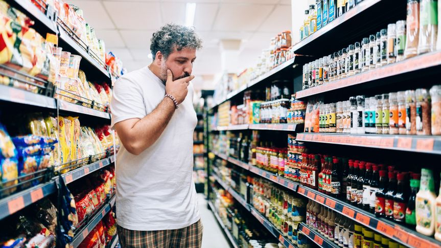 Man shopping at market grocery store.