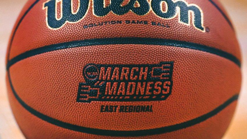 """The """"March Madness"""" logo adorns a ball resting on the court during practice at the NCAA men's college basketball tournament in BostonNCAA Basketball, Boston, USA - 22 Mar 2018."""