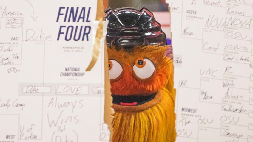 Philadelphia Flyers mascot Gritty looks on after ripping up his NCAA March Madness Bracket during the NHL game between the New York Islanders and Philadelphia Flyers at Well Fargo Center in Philadelphia, PennsylvaniaNHL Islanders vs Flyers, Philadelphia, USA - 23 Mar 2019.