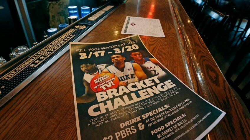 """A poster advertises the """"Bracket Challenge,"""" whereby patrons can complete an NCAA basketball tournament bracket, at Jake's sports bar, in Denver, ."""
