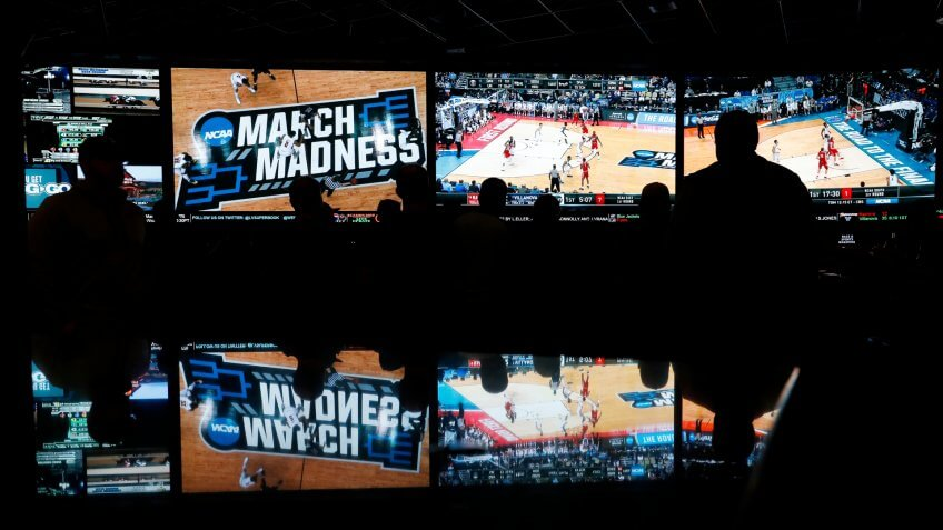 People watch coverage of the first round of the NCAA college basketball tournament at the Westgate Superbook sports book, in Las VegasMarch Madness Betting, Las Vegas, USA - 15 Mar 2018.