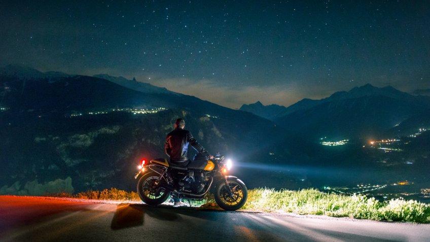 motorcycle driver at night.