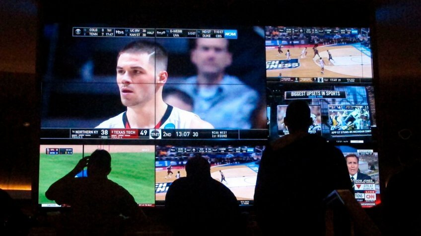 Customers watch a game during the NCAA March Madness college basketball tournament at the Hard Rock casino in Atlantic City N.