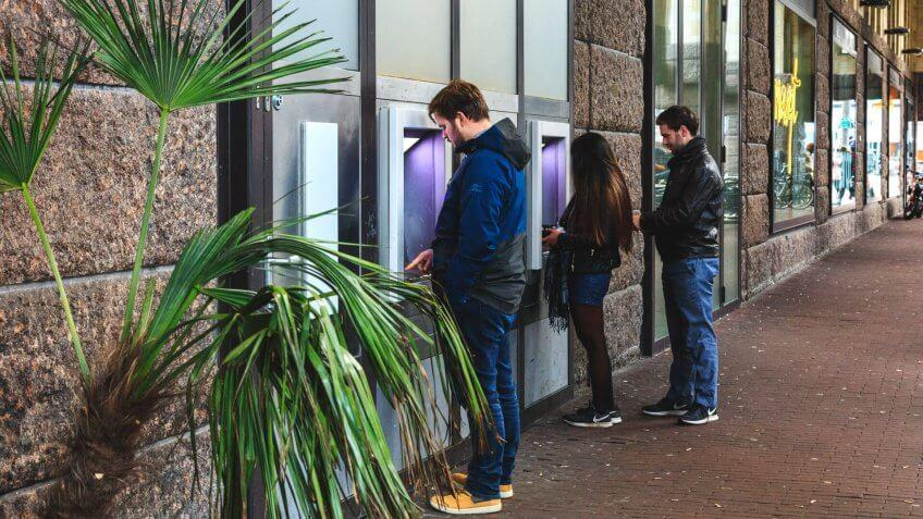 people at bank atms.