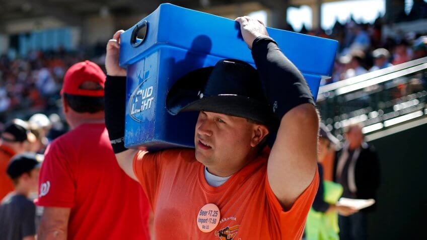 A beer vendor works the stands at Ed Smith Stadium during an exhibition spring training baseball game between the Baltimore Orioles and the Boston Red Sox at Ed Smith Stadium in Sarasota, FlaRed Sox Orioles Spring Baseball, Sarasota, USA.