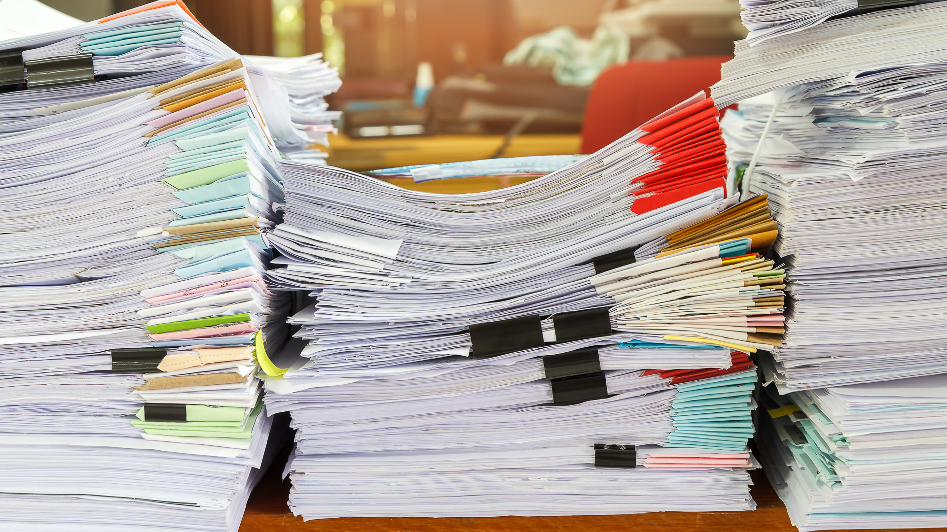 Close up of business documents stack on desk , report papers stack.