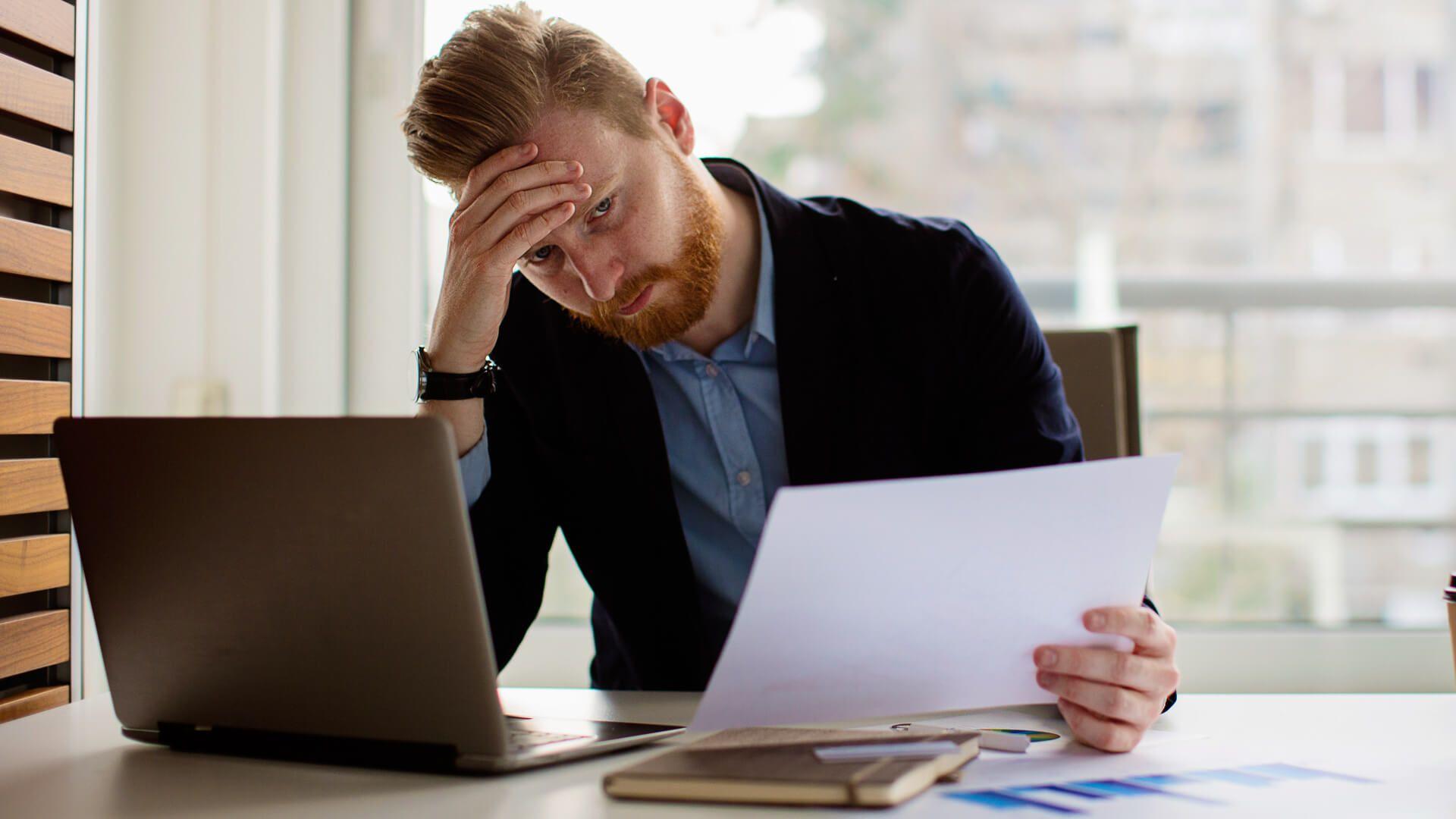 Young businessman under stress.