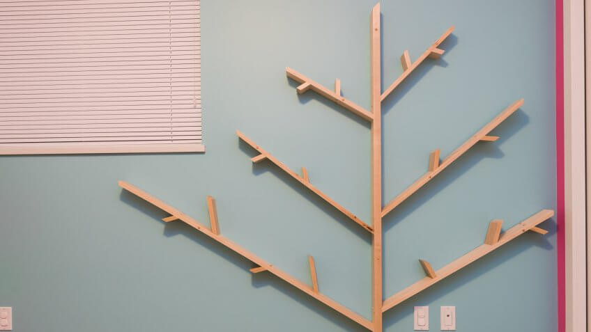 Homemade tree bookshelf made from solid maple in a kids room.