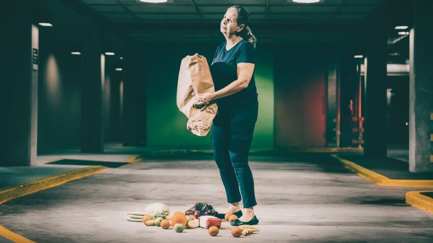 woman dropping her groceries