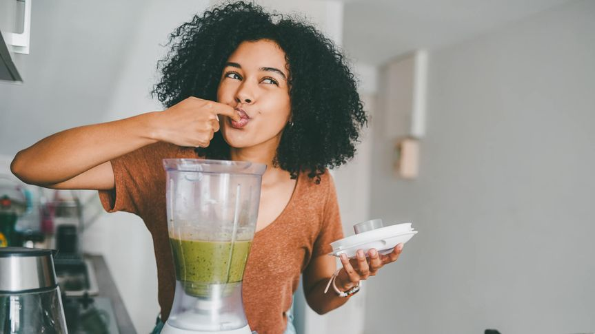 woman making healthy smoothie