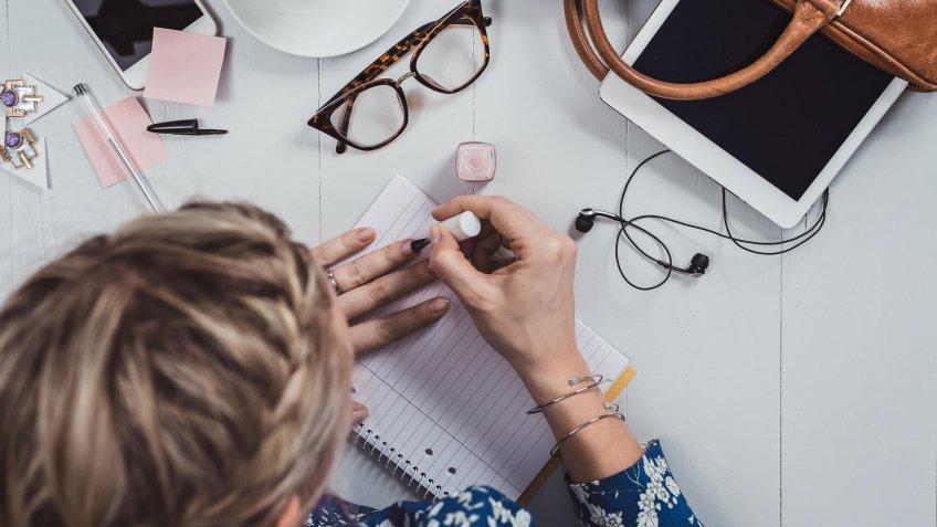 Overhead Business Angles woman at office desk with supply.