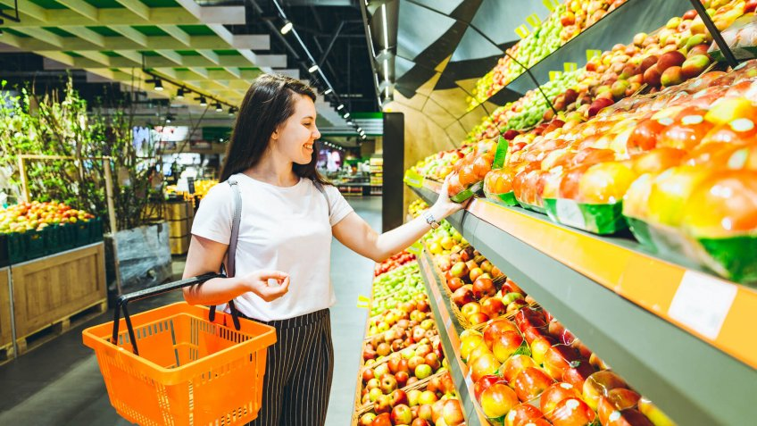 young woman do shopping in supermarket.