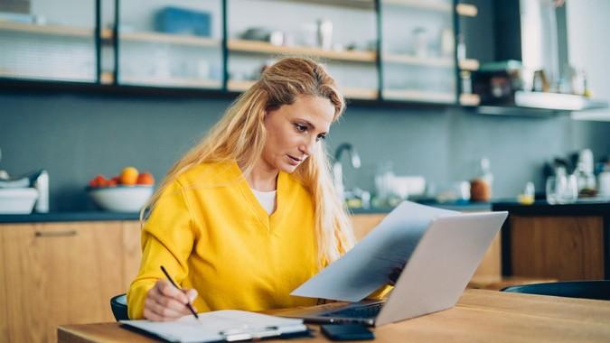 Cute Blonde Freelancer Using Her Living Room As Office.