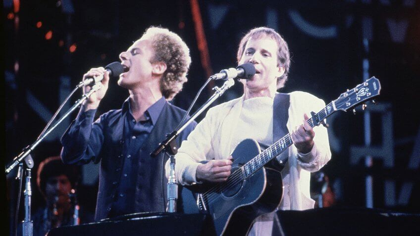 Mandatory Credit: Photo by John Glanville/AP/Shutterstock (7359300a)American pop duo Art Garfunkel, left, and Paul Simon serenade an audience during a concert in London, England in June 1982London Simon Garfunkel, London, United Kingdom England.