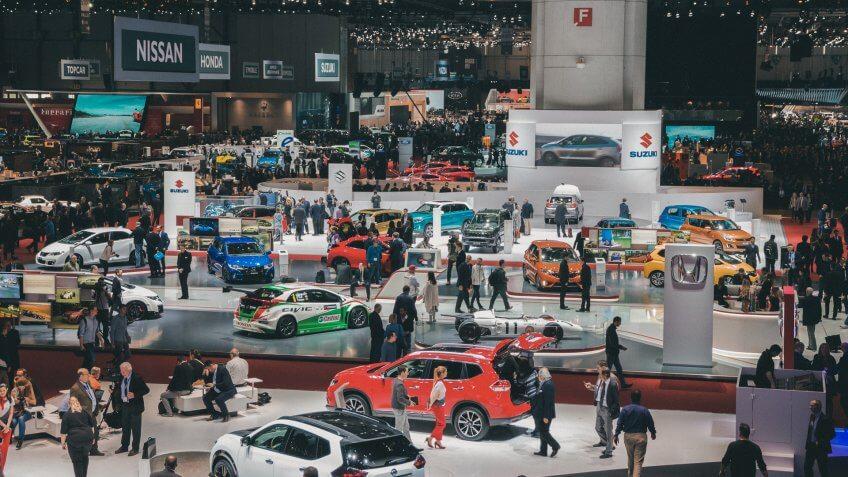 Geneva, Switzerland - March 1, 2016: People and cars at the 86th International Geneva Motor Show in Palexpo, Geneva.