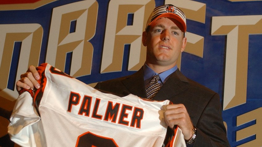 Mandatory Credit: Photo by Ed Betz/AP/Shutterstock (6032801b)PALMER Carson Palmer, a quarterback from Southern Cal, holds up a Cincinnati Bengals jersey after they selected him as the No.