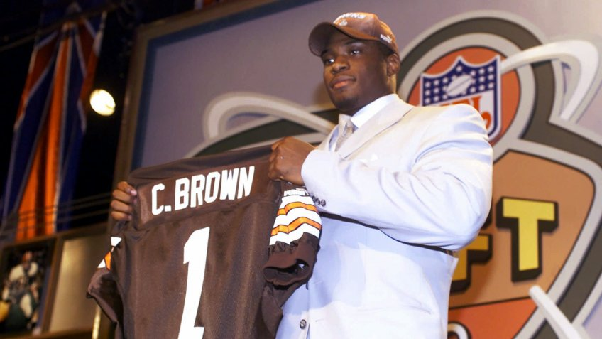 Mandatory Credit: Photo by Ed Betz/AP/Shutterstock (6032812a)BROWN Defensive end Courtney Brown, from Penn State, holds up a Cleveland Browns jersey after being selected by the Browns as the No.