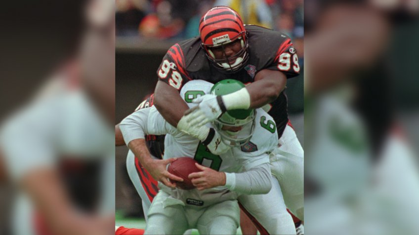 Mandatory Credit: Photo by Tom Uhlman/AP/Shutterstock (6508854a)WILKINSON BRISTER Cincinnati Bengals defensive tackle Dan Wilkinson (99) sacks Phildelphia Eagles quarterback Bubby Brister (6) during the second half, in CincinnatiBENGALS EAGLES, CINCINNATI, USA.