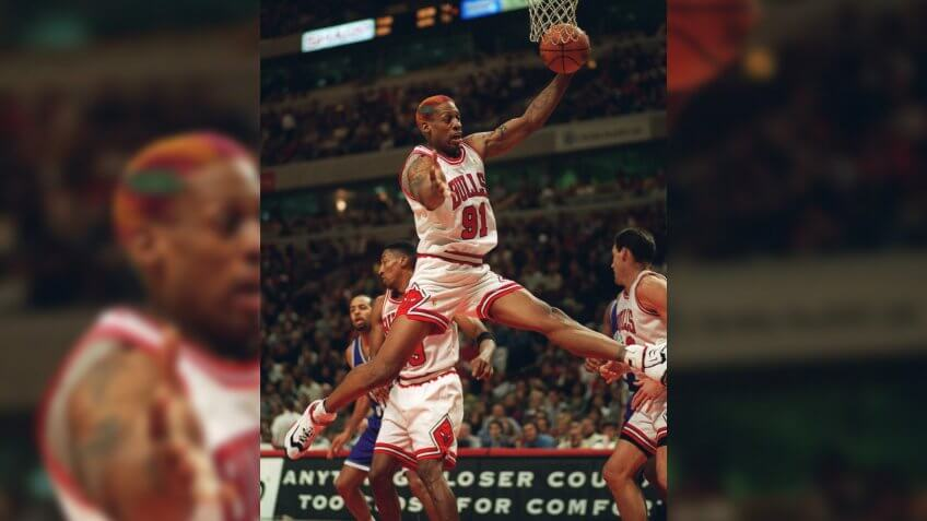 RODMAN Chicago Bulls' Dennis Rodman grabs a rebound during the second quarter of the Bulls' 87-82 defeat of the Charlotte Hornets, in Chicago.