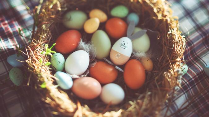 Easter decoration with crafted Easter bunny in the sunny nest.