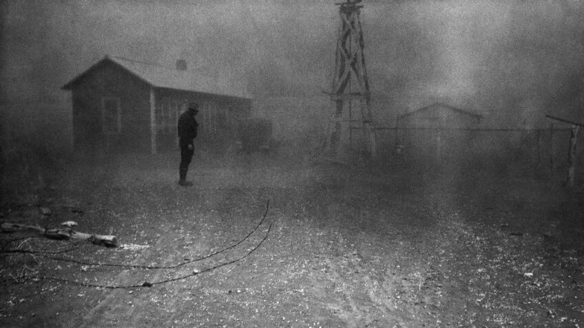 Farmer stands in a dust storm in New Mexico, Spring 1935.