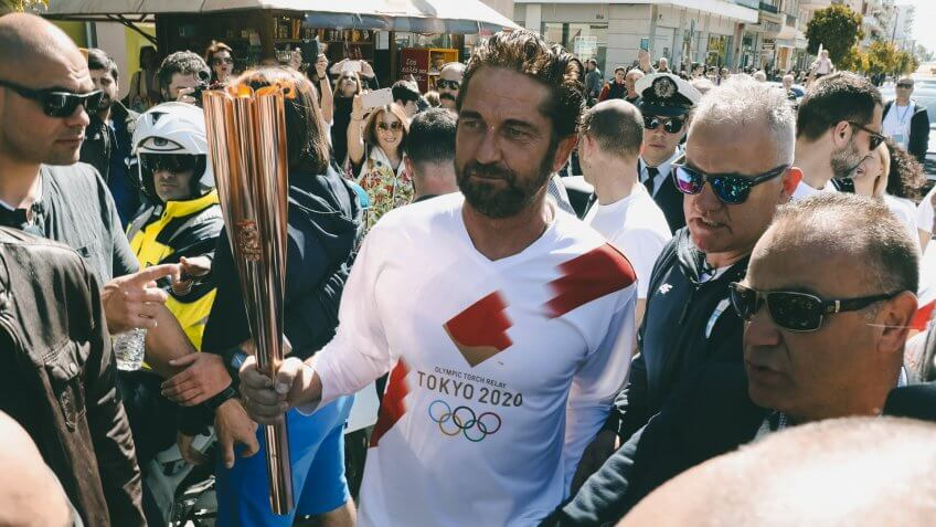 Mandatory Credit: Photo by Uncredited/AP/Shutterstock (10582064g)Actor Gerard Butler runs as a torchbearer during the Olympic torch relay of the 2020 Tokyo Olympic Games in the southern Greek town of Sparta, .