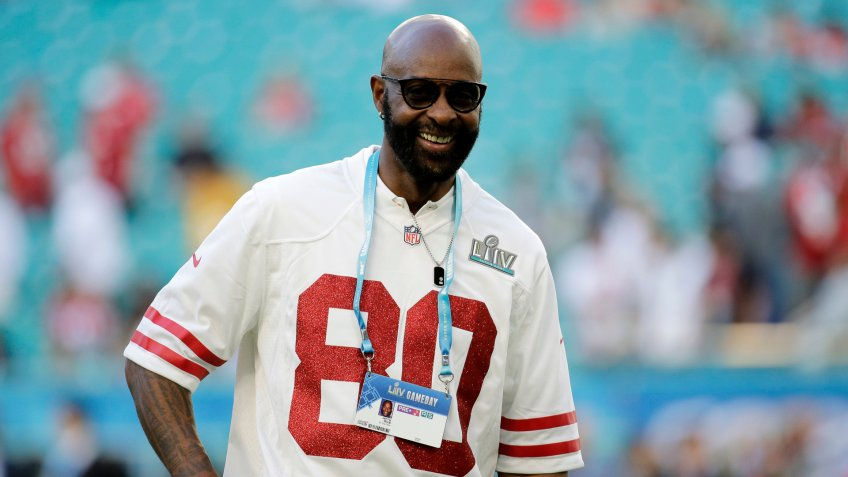 Former NFL player Jerry Rice walks on the field before the NFL Super Bowl 54 football game between the San Francisco 49ers and Kansas City Chiefs, in Miami Gardens, Fla49ers Chiefs Super Bowl Football, Miami Gardens, USA - 02 Feb 2020.